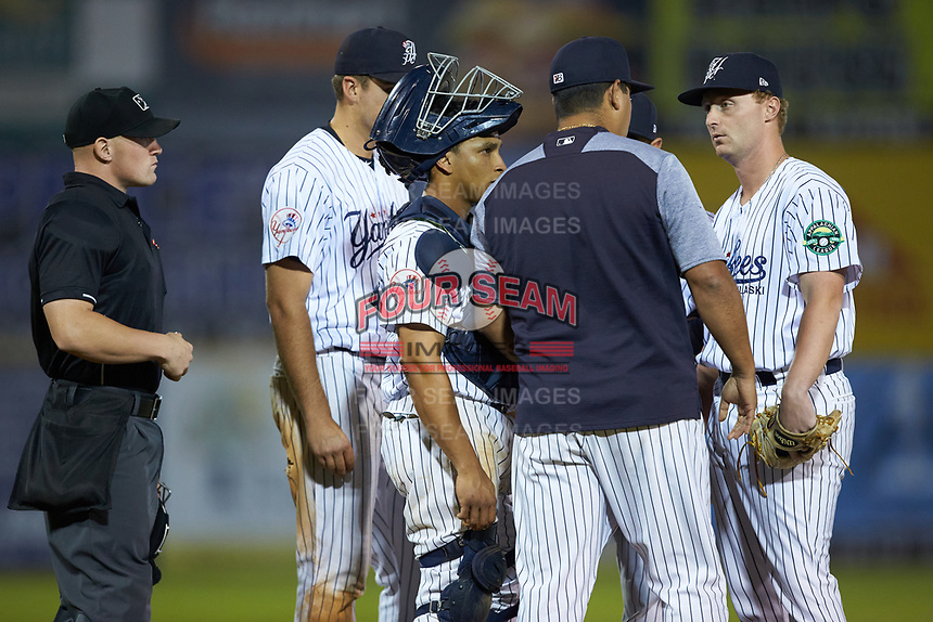 Pulaski Yankees relief pitcher Evan Voliva (right) listens to Pulaski Yankees pitching coach Gerardo Casadiego during the game against the Burlington Royals at Calfee Park on September 1, 2019 in Pulaski, Virginia. The Royals defeated the Yankees 5-4 in 17 innings. (Brian Westerholt/Four Seam Images)