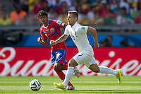 Jack Wilshere of England and Christian Bolanos of Costa Rica