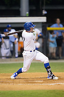 Zane Evans (17) of the Burlington Royals follows through on his swing against the Bluefield Blue Jays at Burlington Athletic Stadium on June 27, 2016 in Burlington, North Carolina.  The Royals defeated the Blue Jays 9-4.  (Brian Westerholt/Four Seam Images)