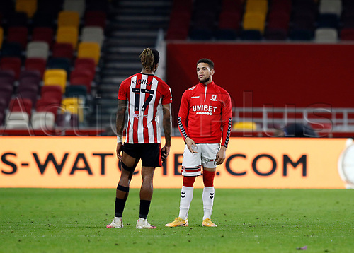 7th November 2020; Brentford Community Stadium, London, England; English Football League Championship Football, Brentford FC versus Middlesbrough; Marcus Browne of Middlesbrough talking to Ivan Toney of Brentford after full time
