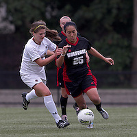 NC State forward Tanya Cain (25) brings the ball forward as Boston College midfielder/defender Alicia Blose (13) pressures. Boston College defeated North Carolina State,1-0, on Newton Campus Field, on October 23, 2011.