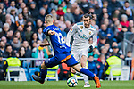 Gareth Bale (R) of Real Madrid fights for the ball with Rodrigo Ely of Deportivo Alaves during the La Liga 2017-18 match between Real Madrid and Deportivo Alaves at Santiago Bernabeu Stadium on February 24 2018 in Madrid, Spain. Photo by Diego Souto / Power Sport Images