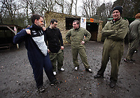 Pictured: Manager Brendan Rodgers (3rd L) with other members of training staff. Tuesday 25 January 2011<br /> Re: Swansea City FC footballers and staff have spend a morning at Teamforce Paintball in Llangyfelach near Swansea south Wales.