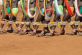 Pará State, Brazil. Aldeia Kokraimoro (Kayapo); girls in full body paint wearing beads and brightly coloured Lycra shorts and flipflops dancing during the Festa de Jabuti (land tortoise festival).