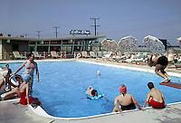 1958 photograph of families enjoying the Seacomber Motel pool.