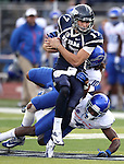 Nevada quarterback Cody Fajardo runs against Boise State defenders Jeremy Ioane (10) and Jerrell Gavins (4) during the second half of an NCAA college football game on Saturday, Dec. 1, 2012,  in Reno, Nev. Boise State won 27-21. (AP Photo/Cathleen Allison)