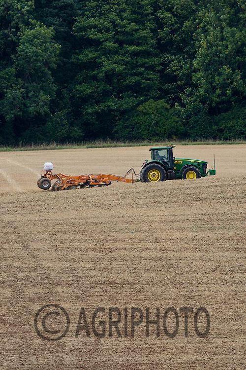 John Deere tractor working in a rolling landscape.©Tim Scrivener,Vine Cottage,Barholm,Stamford,.Lincolnshire,PE9 4RA.