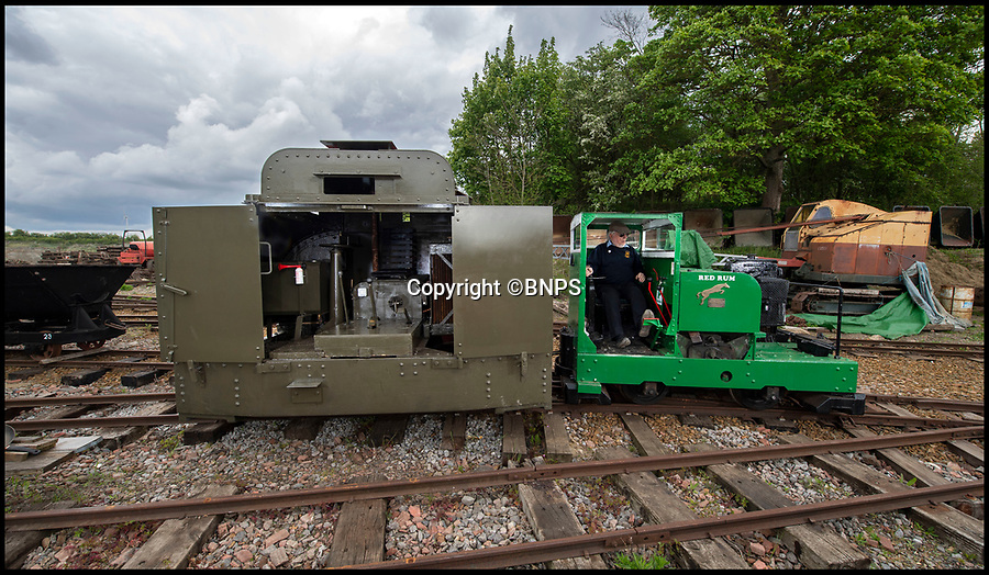 BNPS.co.uk (01202 558833)<br /> Pic: PhilYeomans/BNPS.<br /> <br /> Leighton Buzzard volunteer Tony Tomkins pulls out the armoured train...<br /> <br /> Old War Horse...back on track.<br /> <br /> The last surviving armoured locomotive used to pull munitions to the front line in World War One has been painstakingly restored a century later.<br /> <br /> Volunteers at the Greensand Trust based in Leighton Buzzard have spent the past decade bringing the historic Simplex 40HP engine back to full working order as part of a £20,000 project.<br /> <br /> The 8ft high, 10ft long loco, resembling a tank, was built in Bedford in 1917 and encased in full armour plating to protect it's plucky driver from enemy shell fire on the Western Front.<br /> <br /> It's petrol engine made it more discreet to use at night close to the front line than larger, noisier and more visible steam trains, which were easier targets for the German guns.<br /> <br /> In a world before health and safety the brave driver sat on the noisy engine, with the petrol tank and a radiator next to him in a fume filled cabin - but despite these privations he was infinitely safer inside than out.