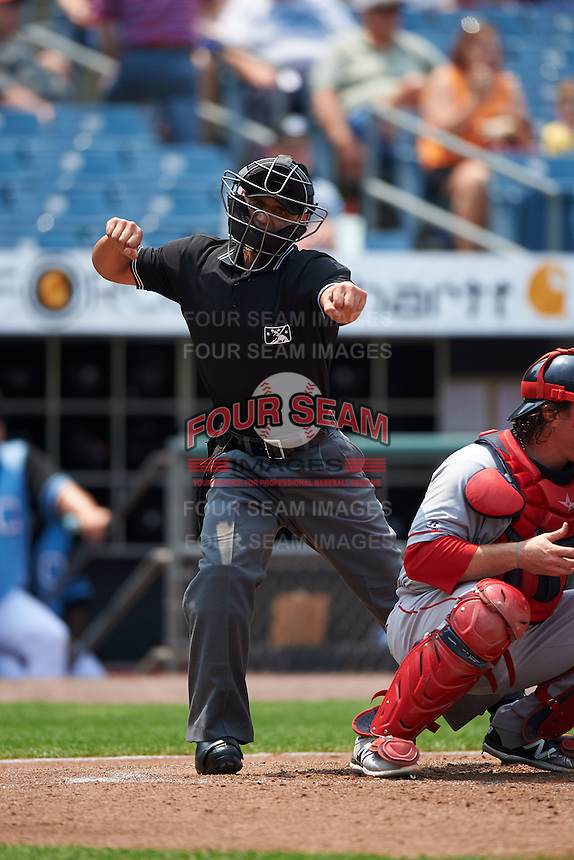 Umpire Joey Amaral makes a call during a game between the Pawtucket Red Sox and Syracuse Chiefs on July 6, 2015 at NBT Bank Stadium in Syracuse, New York.  Syracuse defeated Pawtucket 3-2.  (Mike Janes/Four Seam Images)