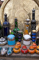 Tripoli, Libya - Antique Glassware, Cosmetic Jars, Copper Market (Suq al-Ghizdir), Tripoli Medina (Old City).  Bottles, Metal Trays.