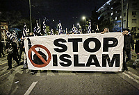 """Members of far right group Golden Dawn (Chrysi Avgi) march with a banner """"Stop Islam"""""""