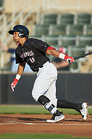 Luis Curbelo (16) of the Kannapolis Intimidators follows through on his swing against the Lakewood BlueClaws at Kannapolis Intimidators Stadium on July 7, 2018 in Kannapolis, North Carolina. The Intimidators defeated the BlueClaws 4-3 in 10 innings.  (Brian Westerholt/Four Seam Images)