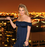 NEW YORK - MAY 14:  (EXCLUSIVE COVERAGE) Tiger woods mistress and 26-year-old  Playboy Playmate and model Loredana Jolie Ferriolo seen at a New York Penthouse at a private party.  on May 14, 2010 in New York City. <br /> <br /> <br /> People:  Loredana Jolie Ferriolo