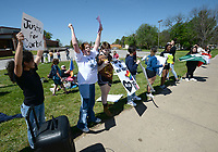 Farmington Junior High School students chants Friday, April 30, 2021, during a protest along main street near the junior high school after a student was allegedly attacked Tuesday at the school by at least one fellow student. Visit nwaonline.com/210501Daily/ for today's photo gallery. <br /> (NWA Democrat-Gazette/Andy Shupe)(NWA Democrat-Gazette/Andy Shupe)