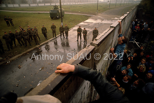 Berlin, Germany<br /> November 11, 1989<br /> <br /> East German police prepare a water canon to stop a group of West Germans as they break through the wall near the Brandenburg Gate. The East German government lifted travel and emigration restrictions to the West on November 9, 1989.