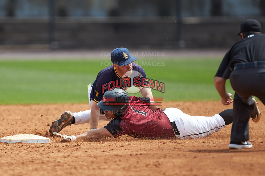 Nick Fajardo (1) of the North Carolina Central Eagles is tagged out by North Carolina A&T Aggies shortstop Dustin Baber (9) at Durham Athletic Park on April 10, 2021 in Durham, North Carolina. (Brian Westerholt/Four Seam Images)
