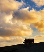 Bench with sunrise clouds. Kailua Beach Park, Oahu, Hawaii