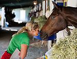 Jill Baffert visits with a horse the Baffert's own, Awesomemundo.