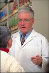 portrait of doctor discussing treatment with elder woman patient