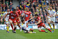 Morgan Parra of ASM Clermont Auvergne and Juan Martin Fernandez Lobbe of RC Toulon go for a loose ball during the Heineken Cup Final between ASM Clermont Auvergne and RC Toulon at the Aviva Stadium, Dublin on Saturday 18th May 2013 (Photo by Rob Munro)