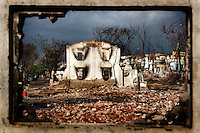 Burned trees and damaged buildings are seen through the window of a destroyed house in the Mingalar Zayyone Muslim quarter, that was razed by Buddhists in ethnic violence in March, in Meikhtila. The now destroyed Mingalar Zayyone Madrassa where Abdul Razak, 15 (also called Ye Myin) was killed. In the four days of ethnic violence starting on March 21st, 2013 over 43 people were killed in Meikhtila and nearly 13,000 people, mostly Muslims, were driven from their homes and businesses. /Felix Features
