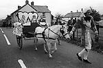 Hatherleigh Fire Festival. Hatherleigh, Devon England 1973. Childrens parade in afternoon. November.