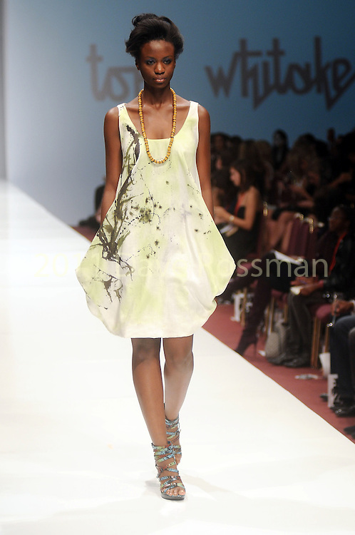A model walks the runway during the Toni Whitaker show on the third day of the Fashion Houston 2010 presented by Audi at the Wortham Theater Wednesday Oct. 13, 2010. (Dave Rossman/For the Chronicle)