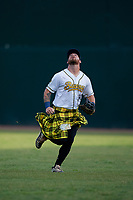 Savannah Bananas right fielder Logan Foster (14) tracks a fly ball during a Coastal Plain League game against the Macon Bacon on July 15, 2020 at Grayson Stadium in Savannah, Georgia.  Savannah wore kilts for their St. Patrick's Day in July promotion.  (Mike Janes/Four Seam Images)