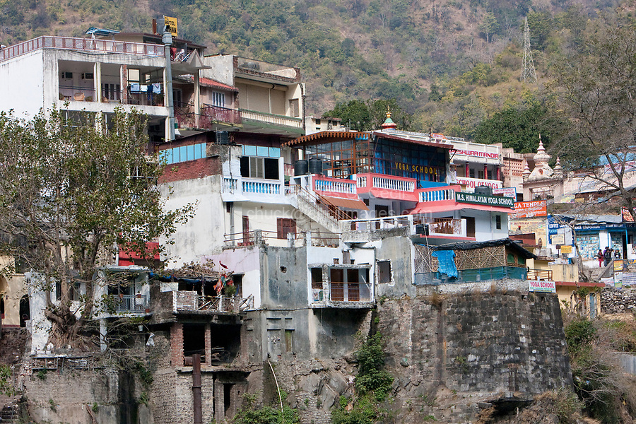 India, Rishikesh.  Buildings on the Hillside leading down to the Ganges (Ganga) River.