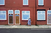 """Terraced street of empty houses belonging to Riverside Housing Association in Liverpool 8.  The city council plans to demolish 6000 properties suffering from """"low demand""""."""