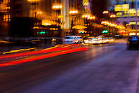Camera blurs of people and things in downtown Chicago on a gold winter evening's rush hour