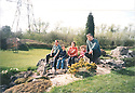 Collect photo from 1996 (estimate).<br /> <br /> Family friends: Phil and Sue Powell with their children, James and George sit with John Massey (right) on the new rockery.<br /> <br /> <br /> All Rights Reserved: F Stop Press Ltd. +44(0)1773 550665   www.fstoppress.com 27/10/16<br /> <br /> You'd be forgiven for thinking that after more than 50 years running a garden nursery, 67-year-old John Massey would be enjoying the peace and tranquillity of retirement.<br /> <br /> But not a bit of it, if anything this keen plantsman is now busier than ever, caring for his own three-acre garden, a beautiful 'all seasons' oasis set in the heart of industrial Birmingham.<br /> <br /> Full story: https://fstoppressblog.wordpress.com/birmingham-garden-in-stunning-autumn-colour/<br /> <br /> With its informal borders, island beds, woodland dells and wildlife meadow, the garden is a riot of colour still, despite the colder evenings and fading daylight hours, showing off an abundance of rare plants as well as many familiar favourites including cyclamen and colchicums, malus trees laden with crab apples and the fiery hues of liquidambar, euonymus and Japanese acers.<br /> <br /> MORE…<br /> <br /> All Rights Reserved: F Stop Press Ltd. +44(0)1773 550665 www.fstoppress.com