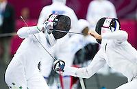 12 AUG 2012 - LONDON, GBR - Chloe Esposito (AUS) (left) of Australia evades an attack from Elena Rublevska of Latvia during their women's London 2012 Olympic Games Modern Pentathlon fencing match at The Copper Box in the Olympic Park, in Stratford, London, Great Britain (PHOTO (C) 2012 NIGEL FARROW)