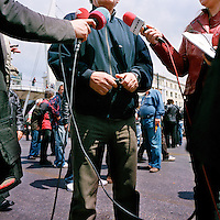 A worker being interviewed about the Piraeus Port workers' strike during the financial crisis.