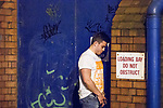 "© Joel Goodman - 07973 332324 . 16/11/2015 . Manchester , UK . A man urinates against a loading bay door . Annual student pub crawl "" Carnage "" at Manchester's Deansgate Locks nightclubs venue . The event sees students visit several clubs over the course of an evening . This year's theme is "" Animal Instinct - unleash your beast "" . Photo credit : Joel Goodman"