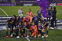 30th August 2020, San Sebastien, Spain;  Lyon players celebrate with trophy after winning the UEFA Womens Champions League football match Final between VfL Wolfsburg and Olympique Lyonnais 3-1