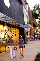 Shoppers walking along Kalakaua Avenue at the Royal Hawaiian Shopping Center in Waikiki. Honolulu, Hawaii