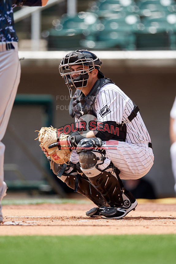 Birmingham Barons catcher Brett Austin (18) during a game against the Jacksonville Jumbo Shrimp on April 24, 2017 at Regions Field in Birmingham, Alabama.  Jacksonville defeated Birmingham 4-1.  (Mike Janes/Four Seam Images)