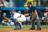 Catcher Josh Vittek (36) of the Burlington Royals and home plate umpire Jeff Morrow at Burlington Athletic Park in Burlington, NC, Saturday, July 26, 2008. (Photo by Brian Westerholt / Four Seam Images)