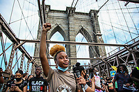 NEW YORK, NEW YORK - June 19: Protesters cross the Brooklyn Bridge on June 19, 2020. People gathered in New York at different locations to celebrate June 15, which remembers the day in 1865. When the soldiers of the Union freed slaves, all movements are celebrated in the context of protests against the murder of George Floyd and other African Americans by the police in the USA. (Photo by Pablo Monsalve / VIEWpress via Getty Images)