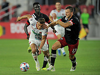 WASHINGTON, DC - JULY 7: Jurguens Montenegro #7 of Liga Deportiva Alajuense battles for the ball with Frederic Brilliant #13 of D.C. United during a game between Liga Deportiva Alajuense  and D.C. United at Audi Field on July 7, 2021 in Washington, DC.