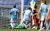 Calcio, Serie A: Lazio vs Roma. Roma, stadio Olimpico, 3 aprile 2016.<br /> Lazio's goalkeeper Federico Marchetti, bottom, saves the ball during the Italian Serie A football match between Lazio and Roma at Rome's Olympic stadium, 3 April 2016.<br /> UPDATE IMAGES PRESS/Riccardo De Luca