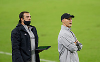 CARSON, CA - OCTOBER 28: LAFC head coach Bob Bradley with assistant Kenny Arena during a game between Houston Dynamo and Los Angeles FC at Banc of California Stadium on October 28, 2020 in Carson, California.