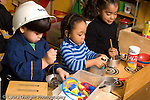 Preschool 3 year olds boy and two girls pretend play in kitchen area dressup horizontal