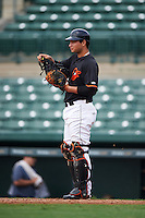 GCL Orioles catcher Daniel Fajardo (34) warms up the pitcher in between innings during the first game of a doubleheader against the GCL Rays on August 1, 2015 at the Ed Smith Stadium in Sarasota, Florida.  GCL Orioles defeated the GCL Rays 2-0.  (Mike Janes/Four Seam Images)