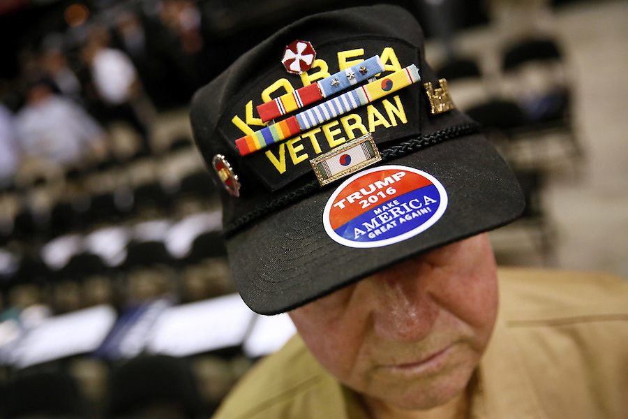 A veteran of both the Korea and the Vietnam War, C.J. Dauzt wears a sticker in support of Republican U.S. presidential candidate Donald Trump before a rally in Baton Rouge, Louisiana in Baton Rouge, Louisiana February 11, 2016. REUTERS/Jonathan Bachman