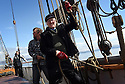 THE BESSIE ELLEN TRAVEL FEATURE.<br /> The crew lower the sails off the island of Lunga in the Inner Hebrides, Scotland.<br /> Retired builder Arthur Winterburn, 73.<br /> Photo:Clare Kendall<br /> 24/05/2016