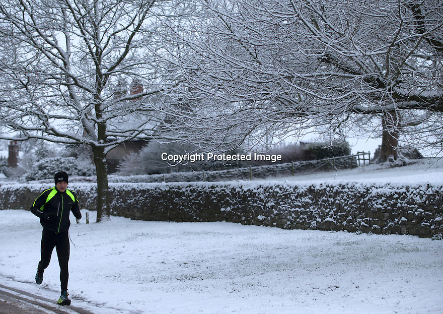 17/01/16<br /> A jogger runs through Tissington in the Derbyshire Peak District near Ashbourne after overnight snowfall.<br /> <br /> All Rights Reserved: F Stop Press Ltd. +44(0)1335 418365   +44 (0)7765 242650 www.fstoppress.com