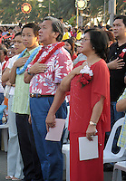 December 4 2004, Manila, Philippines<br />  Manila Mayor Lito Atienza (L) and his wife Beng (R) listen to the national anthem  during a gathering at  Remedios Park in Malate, Manila.<br /> Photo (c) 2004) P Roussel / Images Distribution