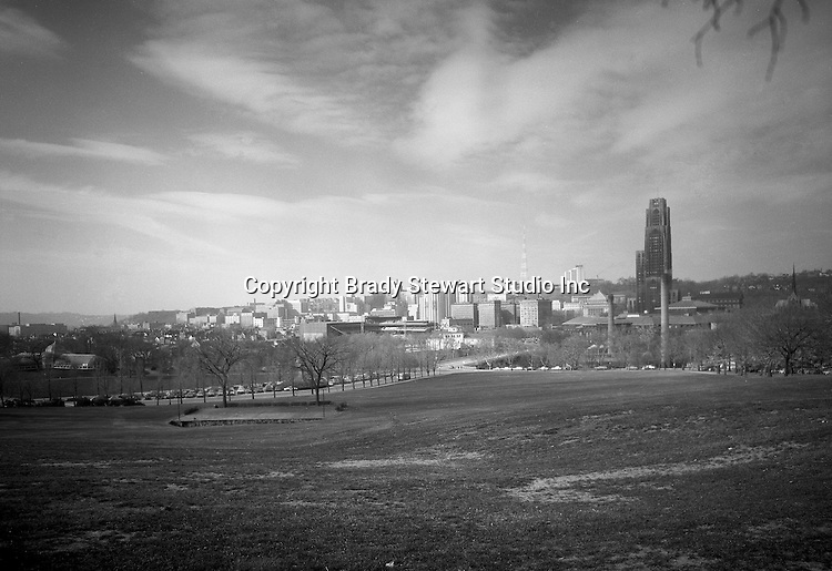 Pittsburgh PA:  View of the University of Pittsburgh's Cathedral of Learning, Forbes Field and Phipps Conservatory from Schenley Park.
